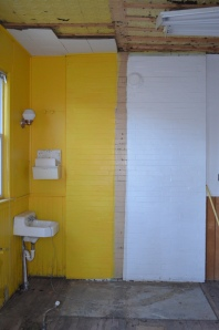 The Wall down showing the  size of the yellow bathroom